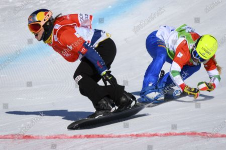 Stock Photo of Winner Eva Samkova (L) of Czech Republic crosses the finish line in front of second placed Michela Moioli of Italy during the women's Snowboard Cross, at the FIS Snowboard Cross, SBX, World Cup Finals in Veysonnaz, Switzerland, 20 March 2021.