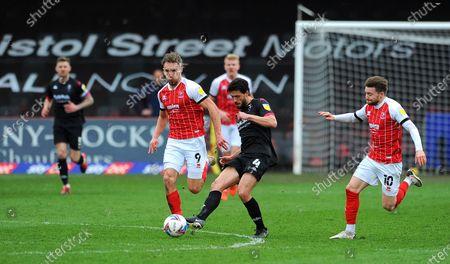 Jason Lowe of Salford City under pressure from Sam Smith of Cheltenham Town- Mandatory by-line: Nizaam Jones/JMP