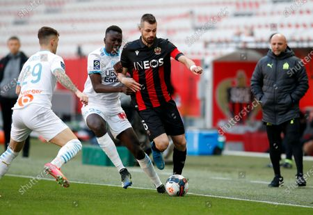 Morgan Schneiderlin (R) of OGC Nice and Pape Gueye (L) of Olympique Marseille in action during the French Ligue 1 soccer match, OGC Nice vs Olympique Marseille, at the Allianz Riviera stadium, in Nice, France, 20 March 2021.