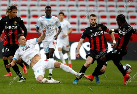 Morgan Schneiderlin (R) of OGC Nice and Arkadiusz Milik (L) of Olympique Marseille in action during the French Ligue 1 soccer match, OGC Nice vs Olympique Marseille, at the Allianz Riviera stadium, in Nice, France, 20 March 2021.