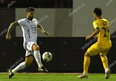 Stock Photo of Al-Shabab's player Ever Banega (L) in action against Al-Taawoun's Abdullah Al-Jawaey (R) during the Saudi Professional League soccer match between Al-Shabab and Al-Taawoun at Prince Khaled bin Sultan Stadium, in Riyadh, Saudi Arabia, 20 March 2021.