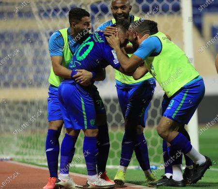 Al-Fateh's player Christian Cueva (2-L) celebrates with teammates after scoring a goal during the Saudi Professional League soccer match between Al-Fateh and Al-Ahli at Prince Abdullah bin Jalawi Stadium, in Al-Hasa, Saudi Arabia, 20 March 2021.