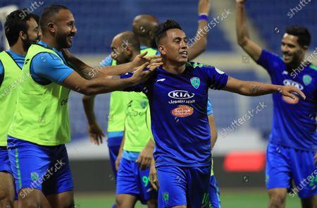 Al-Fateh's player Christian Cueva (C) celebrates with teammates after scoring a goal during the Saudi Professional League soccer match between Al-Fateh and Al-Ahli at Prince Abdullah bin Jalawi Stadium, in Al-Hasa, Saudi Arabia, 20 March 2021.