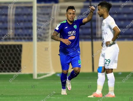 Al-Fateh's player Christian Cueva (L) celebrates after scoring a goal during the Saudi Professional League soccer match between Al-Fateh and Al-Ahli at Prince Abdullah bin Jalawi Stadium, in Al-Hasa, Saudi Arabia, 20 March 2021.