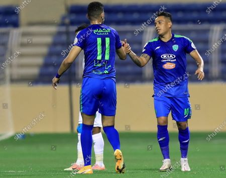 Al-Fateh's player Christian Cueva (R) celebrates with a teammate after scoring a goal during the Saudi Professional League soccer match between Al-Fateh and Al-Ahli at Prince Abdullah bin Jalawi Stadium, in Al-Hasa, Saudi Arabia, 20 March 2021.