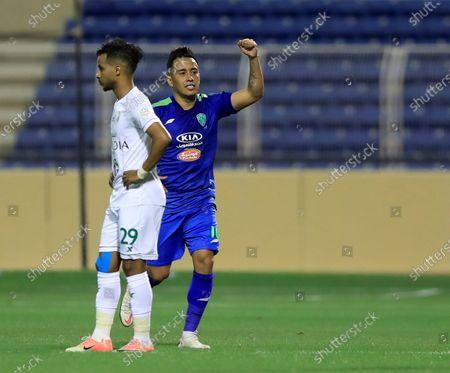 Al-Fateh's player Christian Cueva (R) celebrates after scoring a goal during the Saudi Professional League soccer match between Al-Fateh and Al-Ahli at Prince Abdullah bin Jalawi Stadium, in Al-Hasa, Saudi Arabia, 20 March 2021.