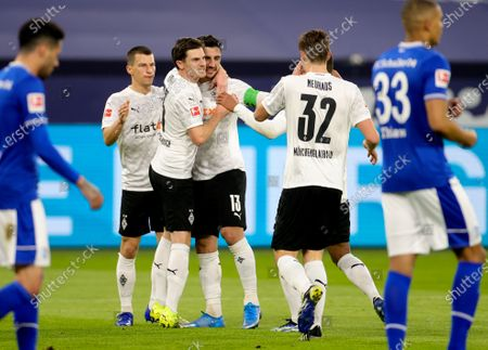 Moenchengladbach's Lars Stindl (C) celebrates with teammates after scoring the opening goal during the German Bundesliga soccer match between FC Schalke 04 and Borussia Moenchengladbach in Gelsenkirchen, Germany, 20 March 2021.