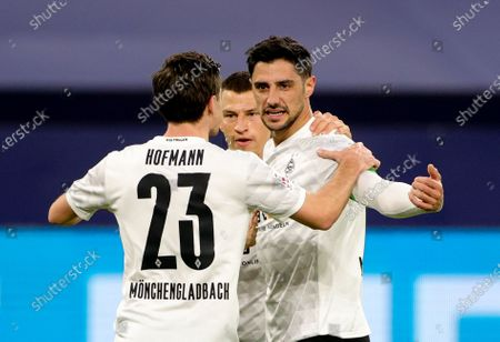 Moenchengladbach's Lars Stindl (R) celebrates with teammates after scoring the opening goal during the German Bundesliga soccer match between FC Schalke 04 and Borussia Moenchengladbach in Gelsenkirchen, Germany, 20 March 2021.