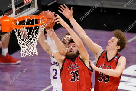 Kansas guard Christian Braun (2) Eastern Washington forward Tanner Groves (35) and Jacob Groves (33) battle for a rebound during the second half of a first-round game in the NCAA college basketball tournament at Farmers Coliseum in Indianapolis