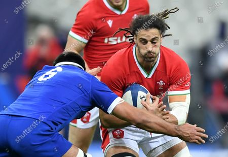 Josh Navidi of Wales is tackled by Dylan Cretin of France.