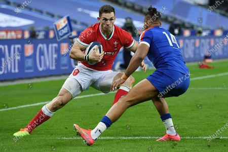 George North of Wales is challenged by Damian Penaud of France.