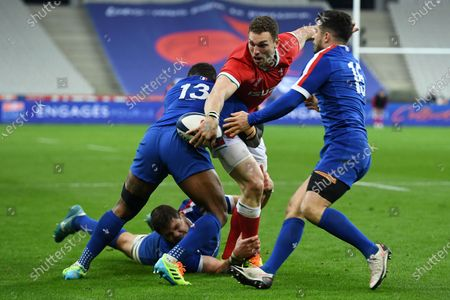 George North of Wales is tackled by Virimi Vakatawa and Paul Willemse of France.
