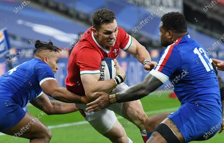 George North of Wales is tackled by Damian Penaud and Virimi Vakatawa of France.