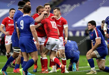 France vs Wales. Wales' Tomas Francis celebrates with try scorer Dan Biggar
