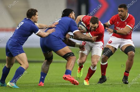 France vs Wales. France's Antoine Dupont and Romain Taofifenua with George North and Taulupe Faletau of Wales