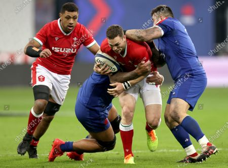 France vs Wales. Wales' Taulupe Faletau and George North tackled by Romain Taofifenua and Cyril Baille of France