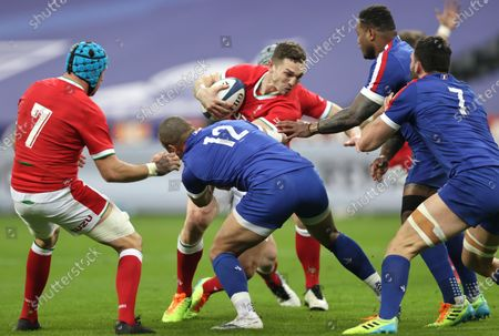 France vs Wales. Wales' George North tackled by Gaël Fickou and Virimi Vakatawa of France