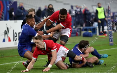 France vs Wales. France's Teddy Thomas and Taulupe Faletau of Wales