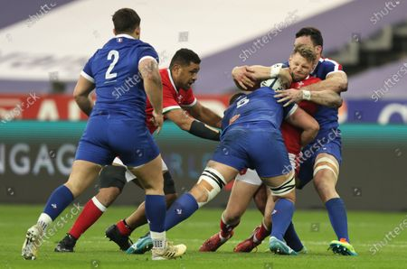France vs Wales. Wales' Dan Biggar tackled by Gregory Alldritt and Charles Ollivon of France