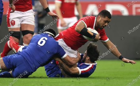 France vs Wales. France's Dylan Cretin and Romain Ntamack tackles Taulupe Faletau of Wales