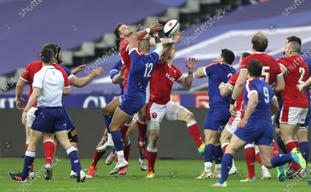 France vs Wales. Wales' Dan Biggar and George North with Gaël Fickou of France