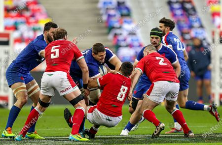 France vs Wales. France's Paul Willemse is tackled by Taulupe Faletau of Wales