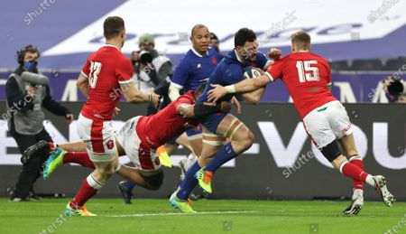 France vs Wales. Wales' Taulupe Faletau and Liam Williams tackles Charles Ollivon of France