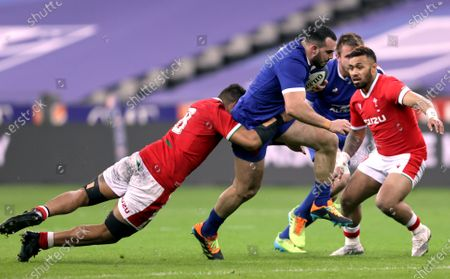 France vs Wales. Wales' Taulupe Faletau and Willis Halaholo with Jean Baptiste Gros of France