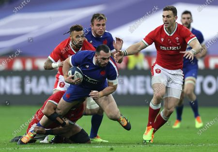 France vs Wales. France's Jean Baptiste Gros with Willis Halaholo and George North of Wales