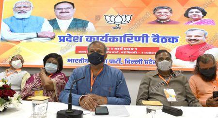 BJP Delhi Pradesh president Adesh Gupta (C), Ramvir Singh Bidhuri, Hans Raj Hans and other leaders during  Delhi Pradesh BJP's executive committee meeting, at BJP headquarters, on March 20, 2021 in New Delhi, India.