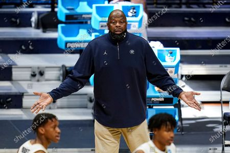 Georgetown head coach Patrick Ewing questions a call in the first half of a first-round game against Colorado in the NCAA men's college basketball tournament at Hinkle Fieldhouse in Indianapolis