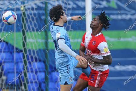 Coventry City's Tyler Walker and Wycombe Wanderers Anthony Stewart during Coventry City vs Wycombe Wanderers, Sky Bet EFL Championship Football at St. Andrew's Trillion Trophy Stadium  on 20th March 2021