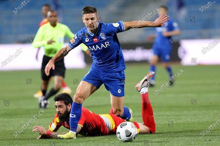 Al-Hilal's player Luciano Vietto (up) in action against Al-Qadisiyah's Rhys Williams (down) during the Saudi Professional League soccer match between Al-Hilal and Al-Qadisiyah at Prince Faisal Bin Fahd Stadium, in Riyadh, Saudi Arabia, 20 March 2021.