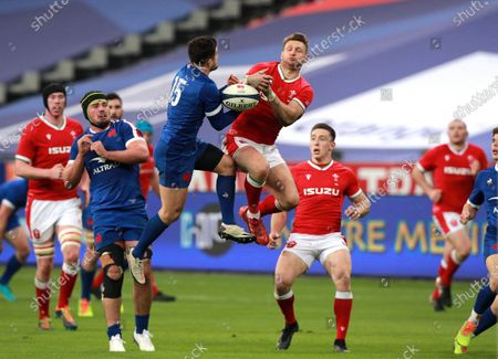 Brice Dulin (C-L) of France and Dan Biggar (C-R) of Wales in action during the Six Nations rugby match between France and Wales at the Stade de France in Saint-Denis, outside Paris, France, 20 March 2021.
