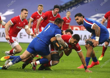 Taulupe Faletau (2-R) of Wales in action during the Six Nations rugby match between France and Wales at the Stade de France in Saint-Denis, outside Paris, France, 20 March 2021.