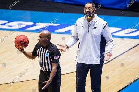 Michigan head coach Juwan Howard questions a call during the second half of a first-round game against Texas Southern in the NCAA men's college basketball tournament, at Mackey Arena in West Lafayette, Ind