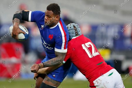 France's Virimi Vakatawa is tackled by Wales' Jonathan Davies during the Six Nations rugby union international between France and Wales at the Stade de France in Saint-Denis, near Paris