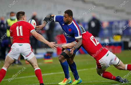 France's Virimi Vakatawa is tackled by Wales' Jonathan Davies, right, and Josh Adams during the Six Nations rugby union international between France and Wales at the Stade de France in Saint-Denis, near Paris
