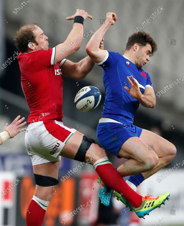 France's Damian Penaud, right, and Wales' Alun Wyn Jones battle for the ball during the Six Nations rugby union international between France and Wales at the Stade de France in Saint-Denis, near Paris