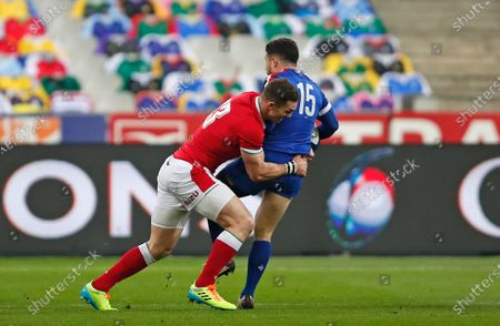 Wales' George North tackles France's Brice Dulin during the Six Nations rugby union international between France and Wales at the Stade de France in Saint-Denis, near Paris
