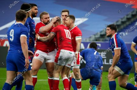 Wales' Dan Biggar, center, after scoring his side's first try during the Six Nations rugby union international between France and Wales at the Stade de France in Saint-Denis, near Paris