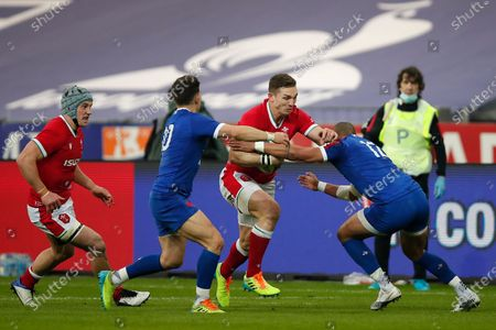 Wales' George North, center, runs with the ball during the Six Nations rugby union international between France and Wales at the Stade de France in Saint-Denis, near Paris
