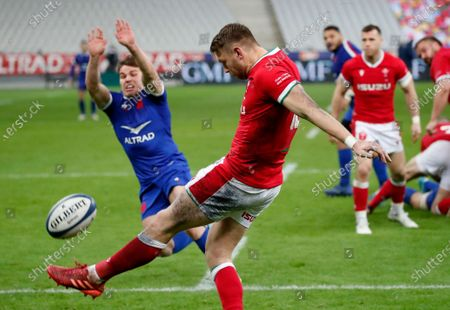 France's Antoine Dupont tries to charge down a kick by Wales' Dan Biggar during the Six Nations rugby union international between France and Wales at the Stade de France in Saint-Denis, near Paris