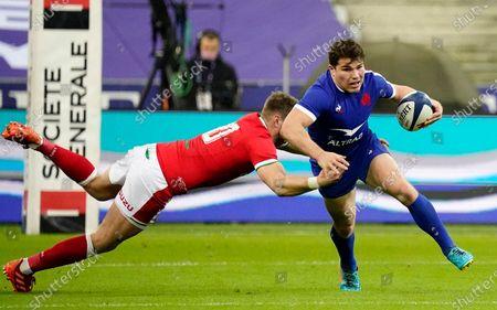 France vs Wales. France's Antoine Dupont is tackled by Dan Biggar of Wales