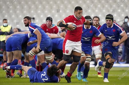 France vs Wales. Wales' Taulupe Faletau is tackled by Romain Ntamack of France
