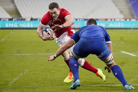 France vs Wales. Wales' George North comes up against Paul Willemse of France