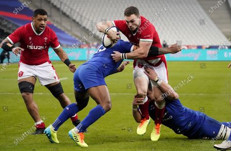 France vs Wales. Wales' George North is tackled by Virimi Vakatawa of France