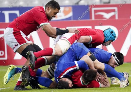 France vs Wales. Wales' Taulupe Faletau with Justin Tipuric and Dylan Cretin of France
