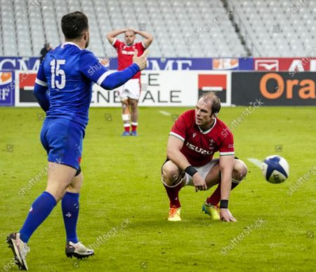 France vs Wales. France's Brice Dulin celebrates after the game while Alun Wyn Jones of Wales is dejected