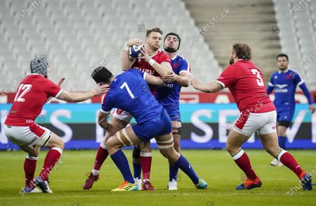 France vs Wales. Wales' Dan Biggar is tackled by Charles Ollivon and Gregory Alldritt of France